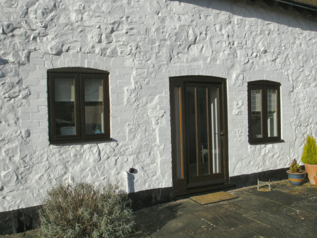 South-facing exterior wall paint touched up